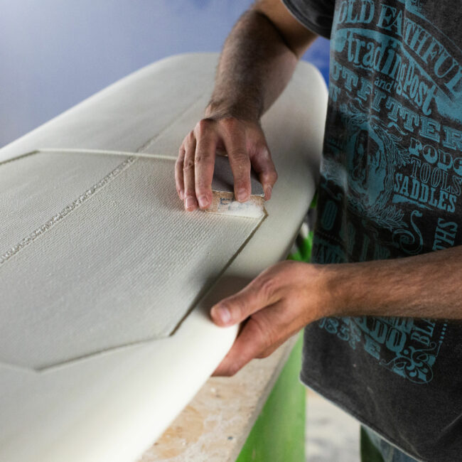 Appletree Surfboards Factory shaping bay sanding
