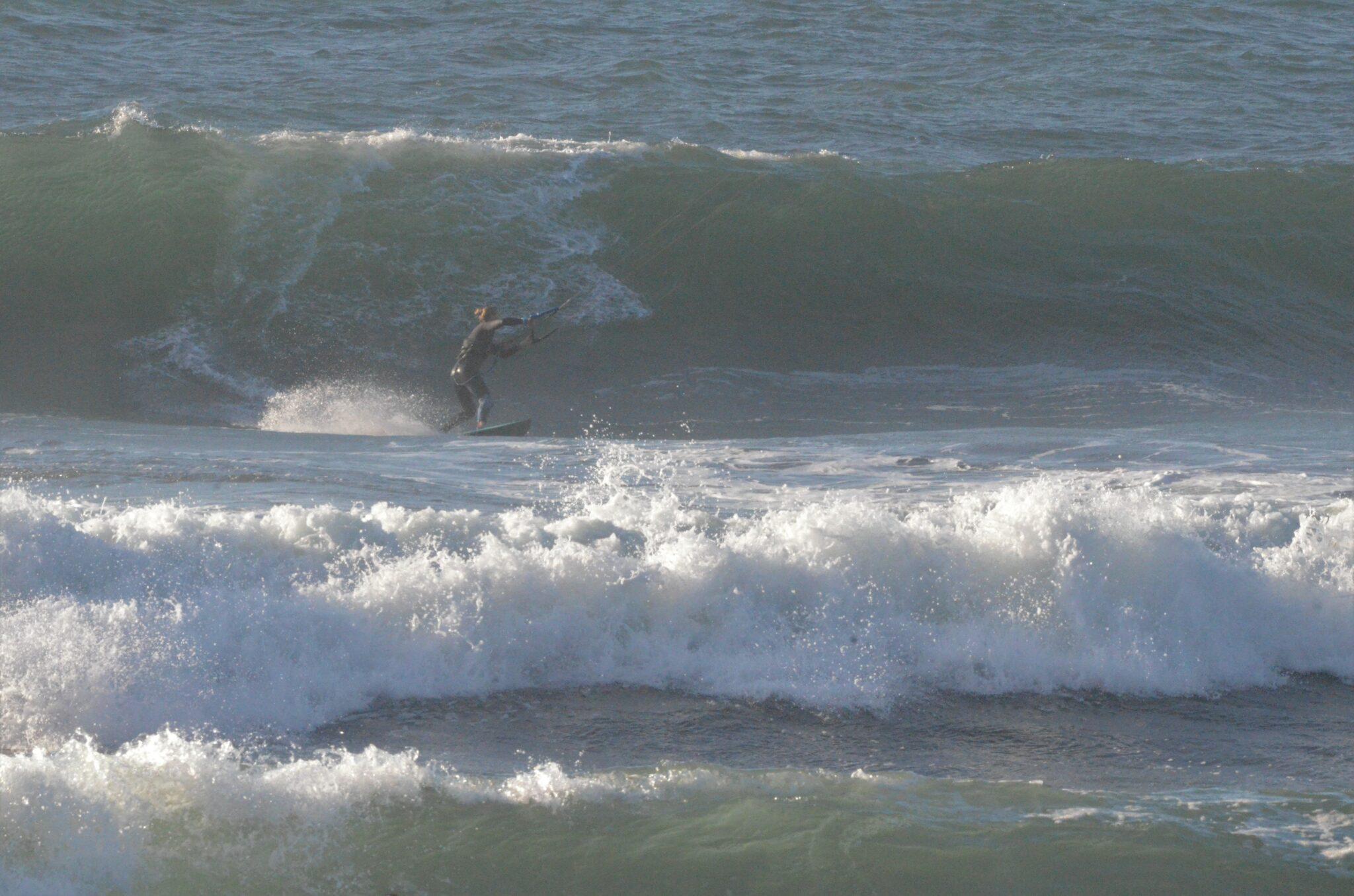 Wave kitesurfing big waves in chile